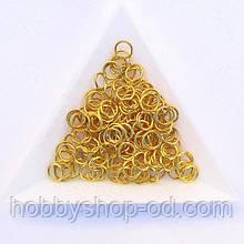 З'єднувальні кільця діаметр 6 мм товщина 0,7 мм золото (приблизно 0,5 кг)