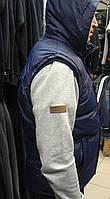 Жилетка универсальная на двойном синтепоне с капюшоном синяя.