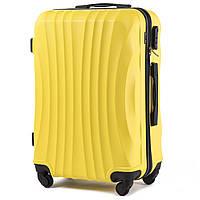 Средний пластиковый чемодан Wings 159 на 4 колесах желтый