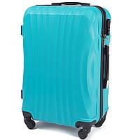 Средний пластиковый чемодан Wings 159 на 4 колесах голубой