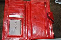 Красный кожаный кошелек на змейке