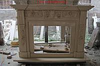 Резной камин из бежового мрамора