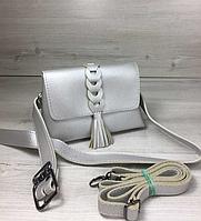 c12012048 Женская сумка на пояс- клатч Белла серебряного цвета с плетением и кисточкой