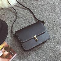 Женская маленькая сумочка на защелке черная оптом из экокожи