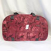 Розовая дорожная сумка