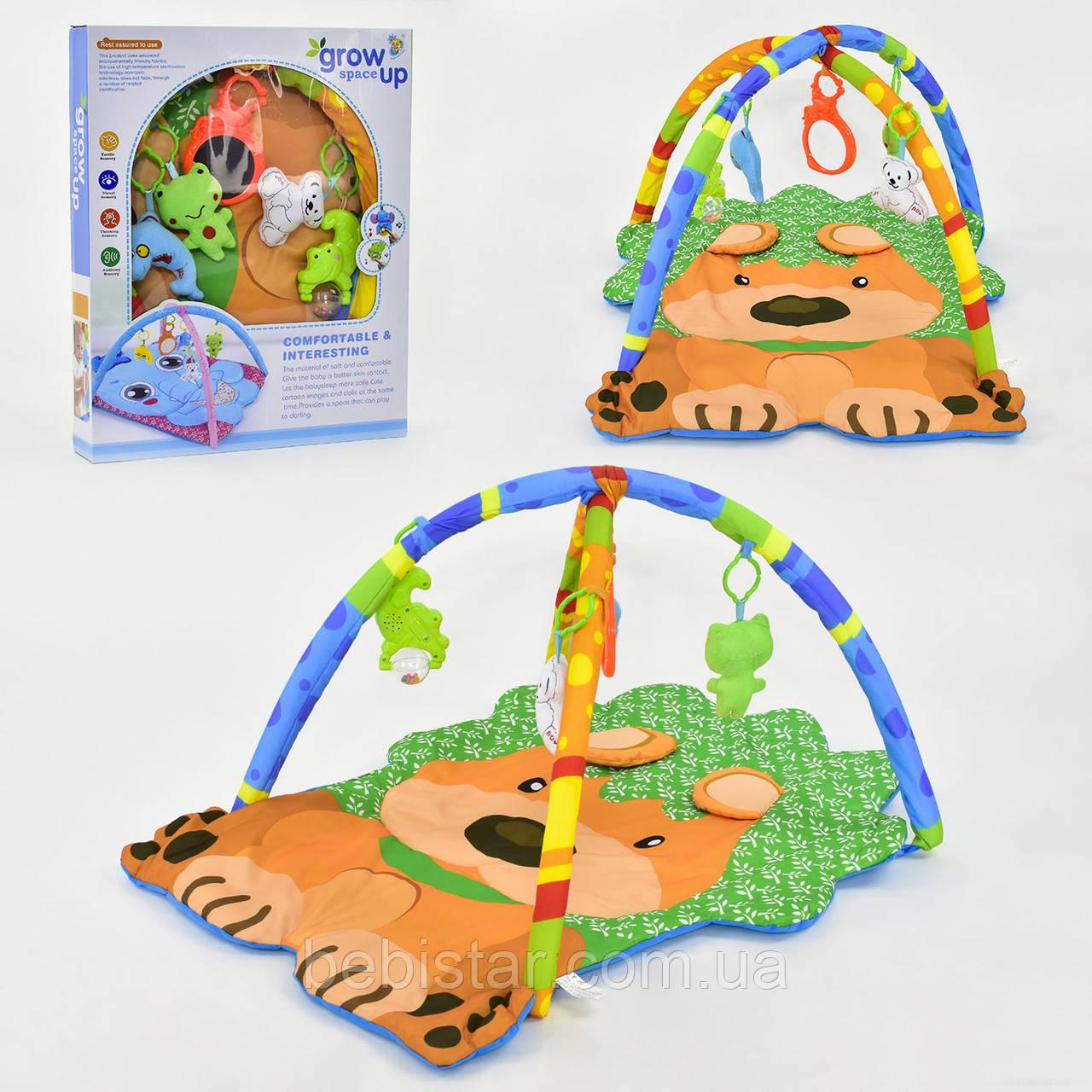 Коврик игровой с мягкой дугой выполнен в форме милой собачки