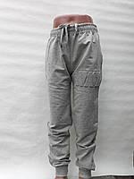 Спортивные штаны для мальчика на 9-12 лет серого цвета оптом