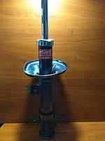 Амортизатор передний Авео в сборе газовый левый (KYB)