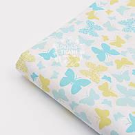Лоскут ткани №963а  с маленькими бирюзово-салатовыми бабочками на белом фоне