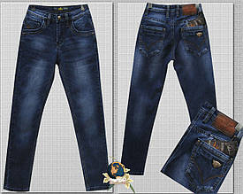Джинсы модные зауженные на мальчика подростка Fangsida синего цвета