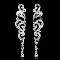 Серьги 9,6*1,9см с белыми кристаллами и каплями