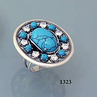 Кольцо из серебра с бирюзой и цирконом.