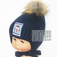 Детская зимняя вязаная шапочка р. 44-52 на флисе с завязками 4363 Синий 44