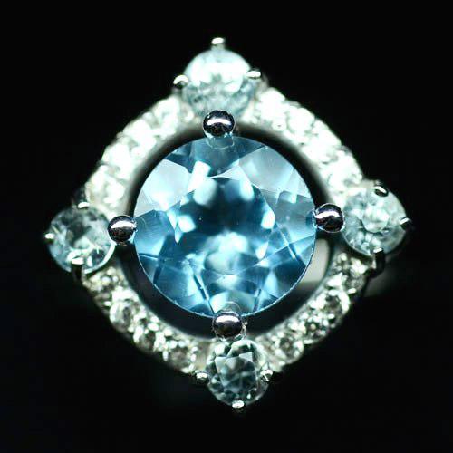 Кольцо с натуральным Небесно-голубым Топазом и фианитами