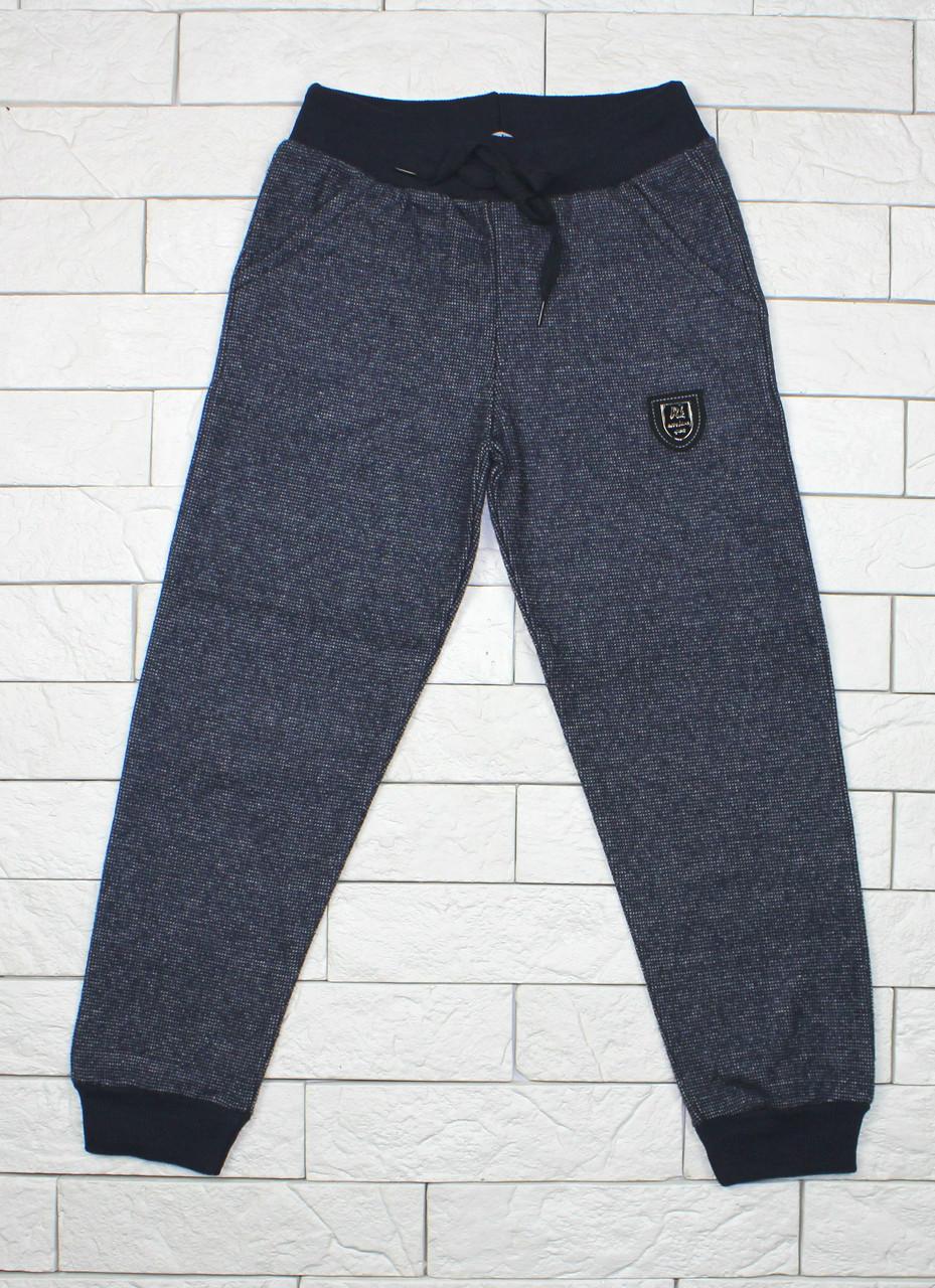 Теплые штаны для мальчика темно-синие
