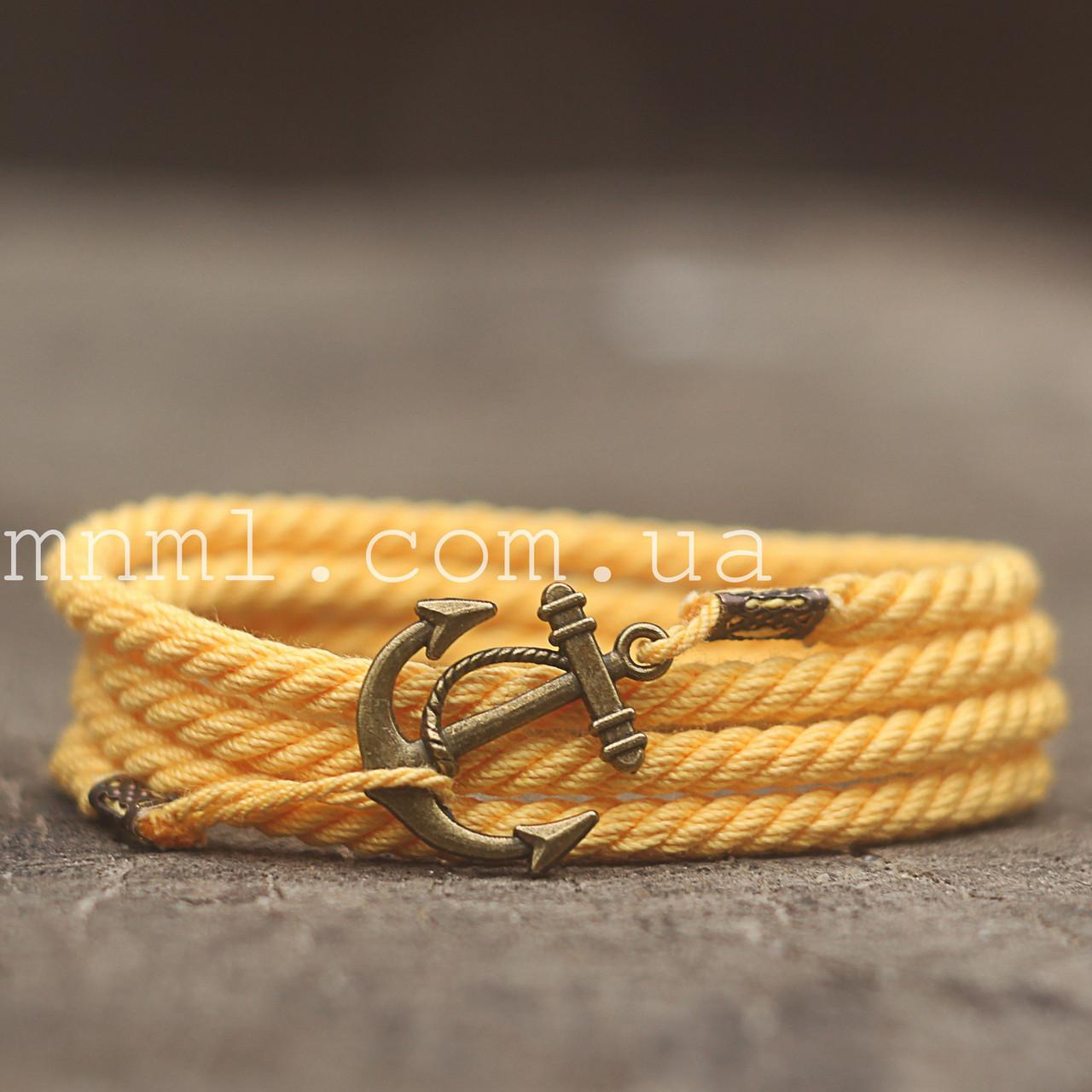 Браслет на руку с якорем желтый