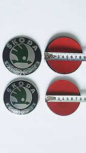 Эмблема  Skoda зелёная диам. 88 мм. и 79 мм.