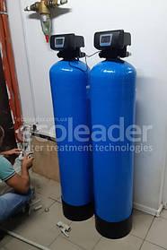 Процесс монтажа системы очистки воды.