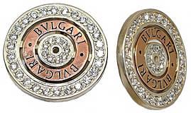 Серебряные серьги с золотыми вставками и цирконием. Диаметр серьги: 2,5 см Английская застёжка.