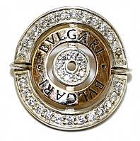 Серебряное кольцо с золотой вставкой. Камни: белый циркон. Диаметр кольца: 2,7 мм. Есть только: 20 р.