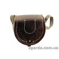 Кожаная сумка декорирована тиснением и металлом
