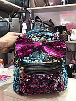 Блестящий рюкзак с бантом