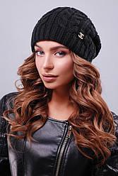 Тепла жіноча в'язана шапка біні в косичку чорна
