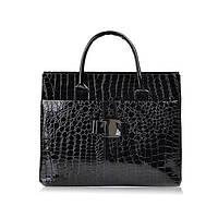 Женская лаковая сумка.
