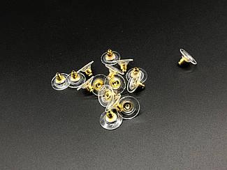Заглушки для сережок залізні з силіконовою вставкою. Колір золото.
