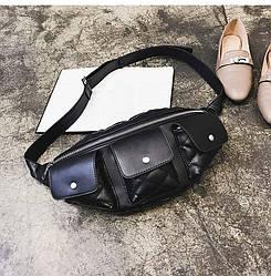 Поясная женская сумка с накладными карманами.