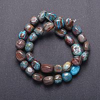 Бусины из натурального камня синий Питерсит на нитке галтовка d-8х9мм L-38см