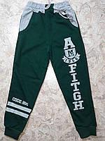 Спортивные штаны для мальчика на 5-8 лет зеленого цвета оптом