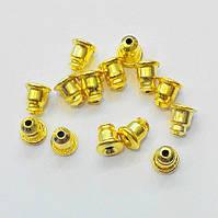 Заглушки для серег железные с силиконовой вставкой (цвет золото) вес примерно 15 г.
