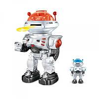 Робот 27107  р/у,30см, звук(англ), свет, ходит, ездит, стрел.дисками, танц, бат,кор,21,5-32-16см