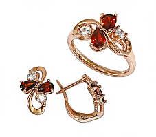 """Набор фирмы Хuping""""серьги и кольцо""""Цвет:позолота с красным оттенком.Камни:бел.,красный циркон.Есть 17р-19р 21р"""