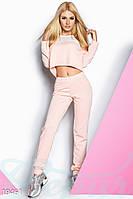 Розовый спортивный костюм с сеткой