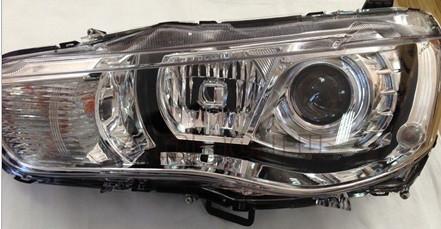Фара Mitsubishi Outlander XL 10-12 правая (FPS) ксенон, линзованная, э
