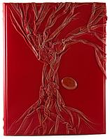 Родословная книга красного цвета с камнем