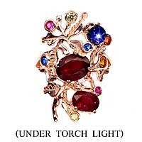 Серебряное кольцо в позолоте с рубинами и звездчатым сапфиром