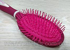 Расческа массажная прорезиненная розовая