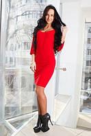 Трикотажное женское платье с глубоким вырезом