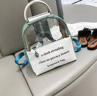 Прозрачный рюкзак с металлическими ручками.
