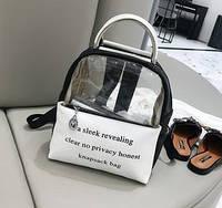 Прозрачный рюкзак с металлическими ручками черный.