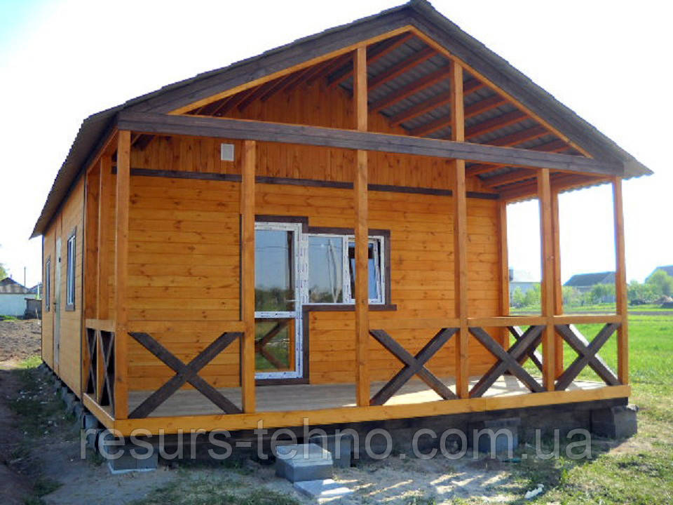 Домик деревянный сборный 9м х 6м с терассой с отделкой фальшбрусом