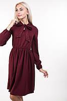 Изысканное женское платье с длинными завязками на воротнике