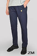 Мужские трикотажные спортивные штаны синие c логотипом желтого цвета