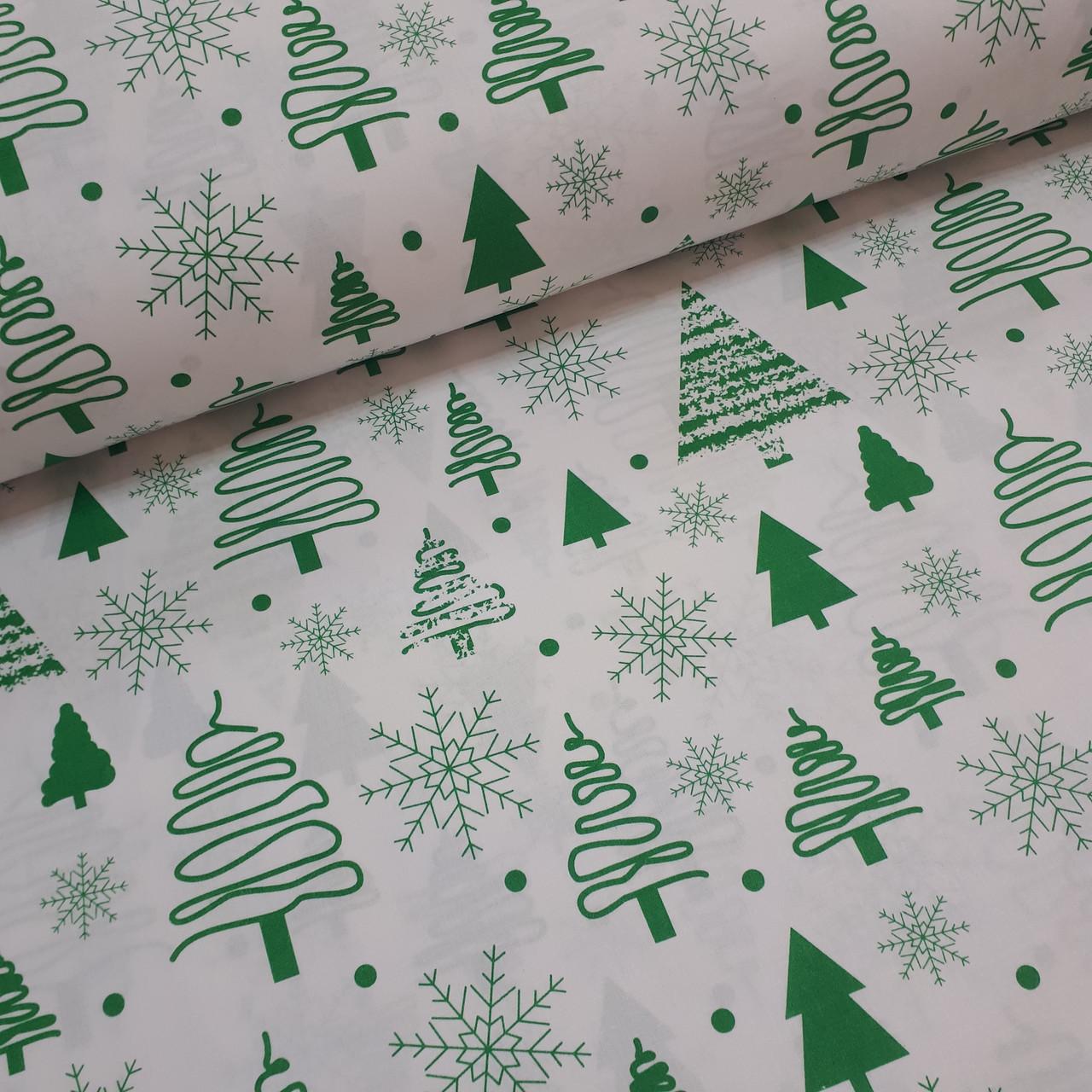 Ткань новогодняя хлопковая, зеленые елочки и снежинки на белом