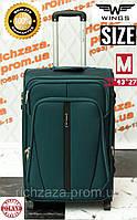 Средний прочный темно-зеленый дорожный чемодан на 2 колесах фирма Wings Одесса Украина