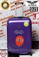Большой пластиковый сиреневый дорожный  чемодан  на 4 колесах фирма Wings Украина Одесса