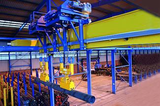 Мостовой кран для распределения стальных труб. Кран мостовой распределительный